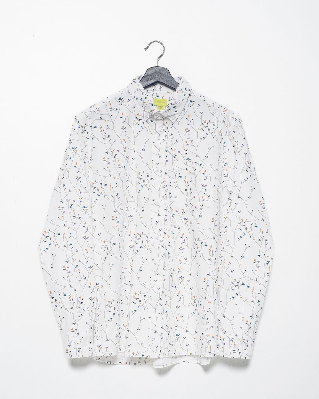Cotton Poplin Weave product flat of a floral vine printed long sleeve shirt